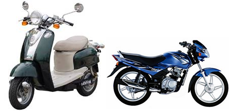 A green motor-driven cycle standing beside a blue motor-driven cycle